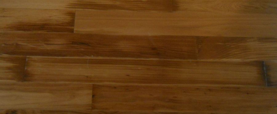 Water Damage To The Surface Of A Hardwood Floor